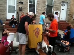 Matt Showing his Art Cart to Onlookers at the 2013 Art Cart Derby