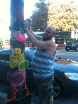 Robert Installing his Light Pole Yarnbomb